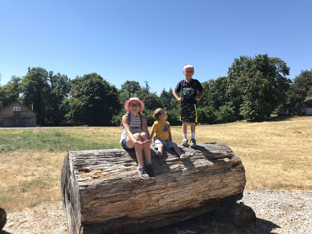 Kids on a giant log at Dorris Ranch - Dorris Ranch Hiking