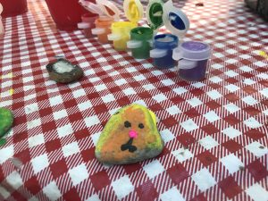 rock painting while camping with kids