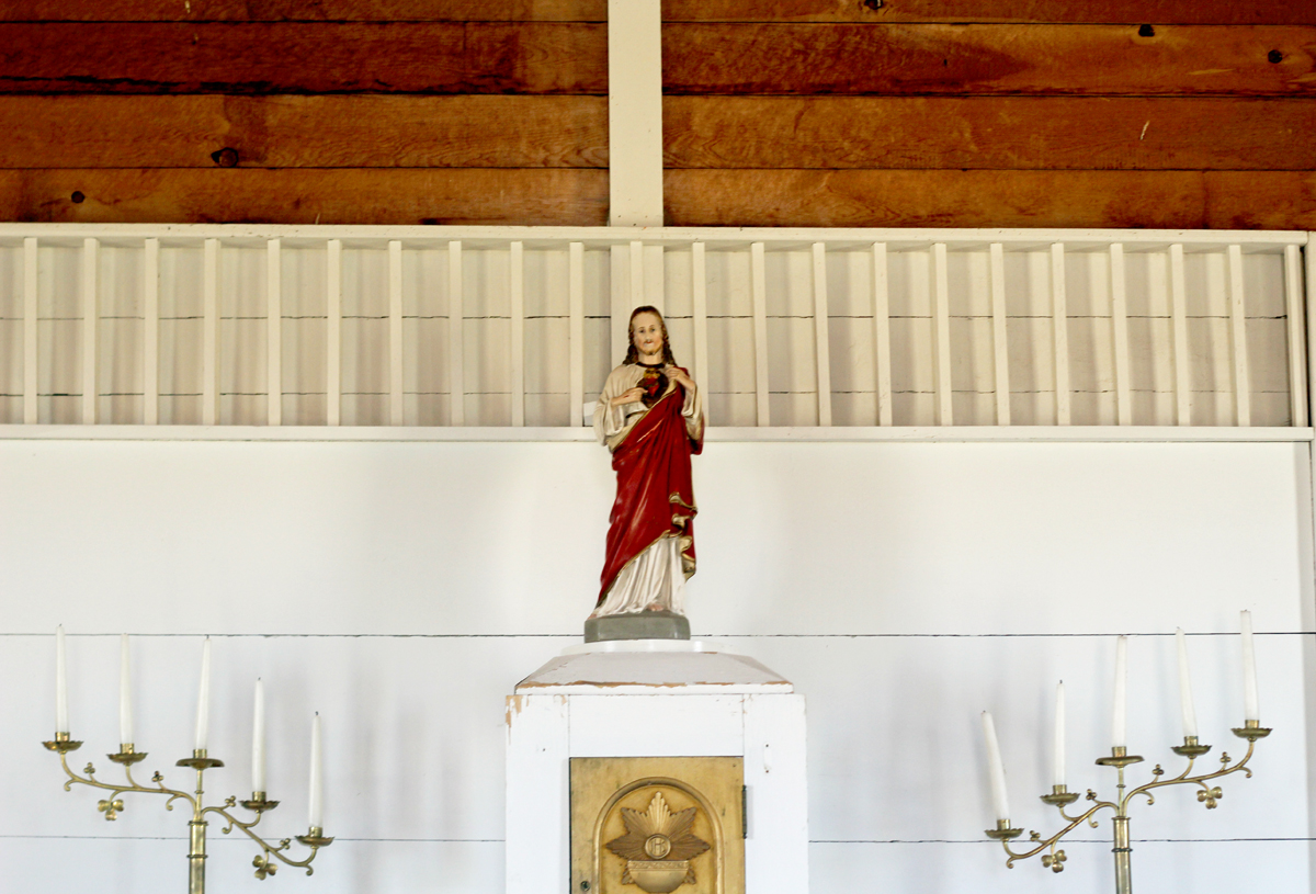 Inside the church at Homestead Village Museum in Fort Rock. Jesus, wrapped in red, stands atop an alter.