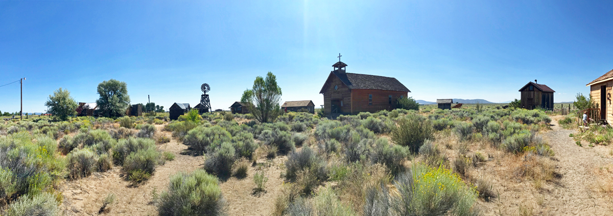 Fort Rock Museum panorama - many old buildings arranged like a settlers village